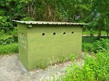 Army bunker. Small green military bunker for defence and shelter in Tengah forest, Singapore Royalty Free Stock Photography