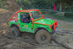Small  green off road in the mud Stock Photography