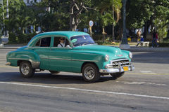 Small Green old Cuban car. Small green old classic Cuban Car driving by, working as a taxi, Havana, Cuba Stock Photos