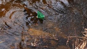 Small green paper boat is flowing along the river. Small green paper boat is flowing along river stock video footage