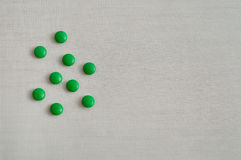 Small green pills Stock Images