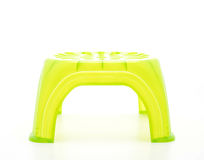 Small green plastic stool Stock Images