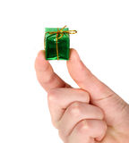 Small green present in man's hand Royalty Free Stock Photography