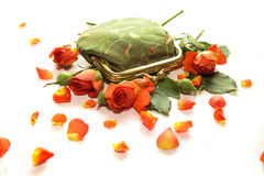 Small green purse in roses Royalty Free Stock Photo