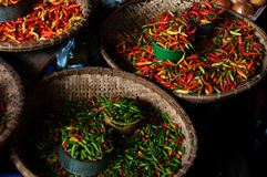 Small Green and Red Chillies at a local Market Stock Image