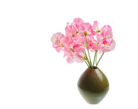 Small green vase with Sweet Pea flower boquet. Royalty Free Stock Photos