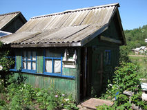 Small green wooden board country house in the village in the Rus Royalty Free Stock Image