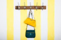 Small green and yellow leather bags stock image