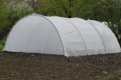 Small greenhouse. A small greenhouse in the yard of a small farmer Stock Photo