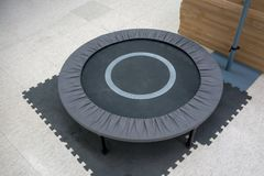 Small grey and black fitness trampolin on foam sheet stock photography