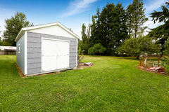 Small grey shed with white trim. Countryside real estate Royalty Free Stock Photography