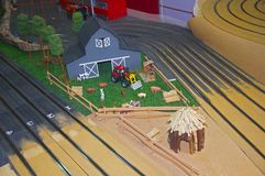 Small grey toy housestock, red tractor and wooden barn stock photos