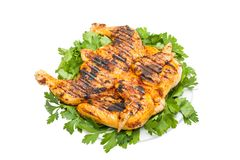 Small grilled chicken on a white dish Royalty Free Stock Images