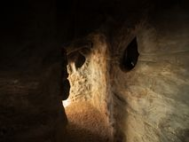 Small grotto cave with textured walls stock photography