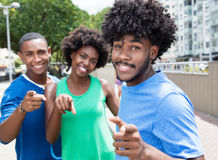 Small group of african american man and woman pointing at camera Royalty Free Stock Photo