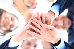 Small group of business people joining hands,. Low angle view Stock Image
