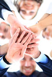 Small group of business people joining hands. Low angle view Royalty Free Stock Photo