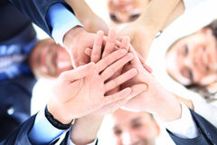 Small group of business people joining hands. Low angle view Royalty Free Stock Photography