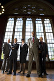 Small group of businessmen and woman in hall, portrait, low angle view Stock Photos