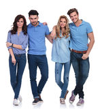 Small group of casual young peolple standing together. Full body picture of a small group of casual young happy peolple standing together on white background Royalty Free Stock Images