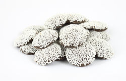 Small group of chocolate covered nonpareils Stock Image