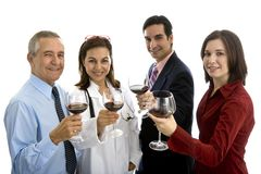Small group of doctor and business people toasting with a glass of wine Stock Photo