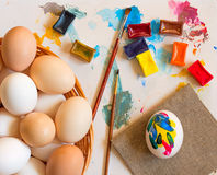 Small group of eggs. Of different colours with Multi-coloured water colour and a brush for drawing stock photography