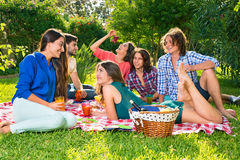 Small group of friends eating grapes on a blanket Stock Photo