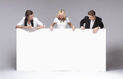 Small group of friends having fun with empty board Stock Image
