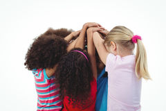 Small group of girls huddled together Royalty Free Stock Image