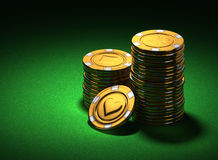 Small group of gold casino chips on green Royalty Free Stock Photos