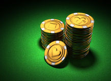 Small group of gold casino chips on green Stock Image