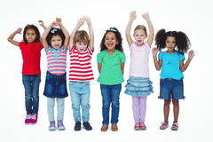 Small group of kids standing together with arms raised Royalty Free Stock Photos