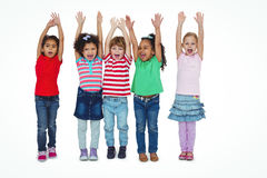 Small group of kids standing together with arms raised Stock Images