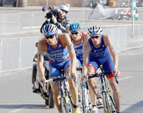 Small group of male cycling triathlon competitors fighting Royalty Free Stock Photo
