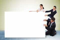 Small group of people holding a blank banner Royalty Free Stock Image