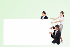 Small group of people holding a blank banner Stock Image