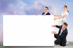 Small group of people holding a blank banner Royalty Free Stock Images
