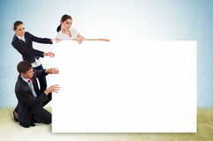 Small group of people holding a blank banner Stock Photo
