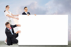 Small group of people holding a blank banner Royalty Free Stock Photo