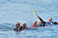 Small Group of people in water rescue Royalty Free Stock Photos