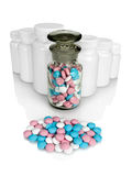 Small group a pill against small bottles with pills. Stock Image