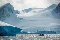 Drip, drip. Zodiac passengers watch water dripping from iceberg royalty free stock photos
