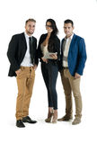 Small group of young business people working standing together Royalty Free Stock Images