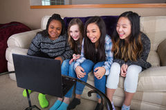 Small group of young girl friends watching streaming tv on compu Stock Photography