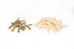 Small groups of screws and dowels. On a white background Stock Photography