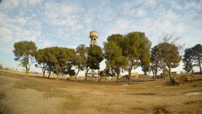 A small grove of trees and a water tower, close to the border between Turkey and Syria. Ancient ruins and houses in Harran - a small Arab city, neighborhood on stock video