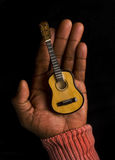 Guitar in palm of hand Stock Photography