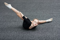 Small gymnast trains in the gym Royalty Free Stock Photography