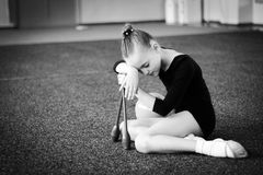 Small gymnast trains in the sport gym Royalty Free Stock Image